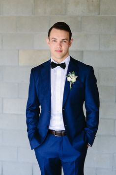Wedding Suits Handsome groom in blue suit with bow-tie Blue Suit Men, Navy Blue Suit, Navy Suits, Blue Bow, Blue Suit Groom, Navy Blue Tuxedos, Navy Groom, Traje Black Tie, Costume Smoking