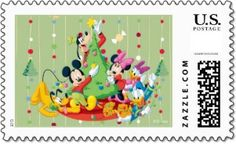 Mickey Mouse, Donald Duck, Goofy and all the Disney gang are decorating their Christmas tree on this fun Disney Christmas stamp.