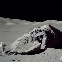 Astronaut Harrison Schmitt stands by a lunar boulder on the Moon during Apollo 17's mission in 1972