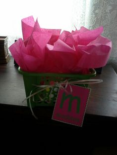 A fun way to wrap a gift. Dollar Tree basket and tissue paper.