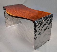 Born in 1955, Rado Kirov is a Bulgarian artist well-known for his hybrid creations. His passion for the work of stainless steel lead him to combine this material with wood, creating texture effects similar to liquefied metal. From his work result a large collection of unexpected sculptures and furniture pieces.