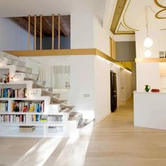 Santpere47 by Miel Arquitectos is a Barcelona apartment divided diagonally by two golden strips