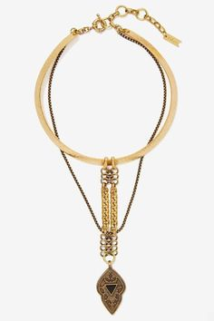 <3 @benitathediva   Gold choker with large pendant.