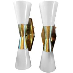 Pair of Atomic Sconces by John C. Virden   From a unique collection of antique and modern wall lights and sconces at https://www.1stdibs.com/furniture/lighting/sconces-wall-lights/