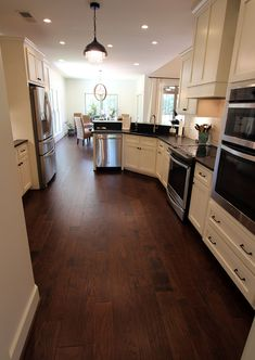 Hickory Ridge Tobacco Road hardwood, white cabinets, black granite, white marble subway tile backsplash