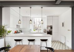 Patterned tiling, oak floorboards and a sliding translucent screen all feature inside this refurbished home in a century London mansion block White Apartment, Apartment Kitchen, Apartment Design, Kitchen Interior, Kitchen Decor, Kitchen Ideas, Küchen Design, House Design, Design Studio