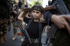 PALESTINIAN GIRL WITH A KALASHNIKOV RIFLE, AMID MILITANTS IN GAZA ...