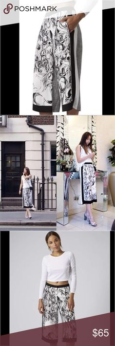 TOPSHOP Marble Check Culottes Black Capris TOPSHOP  SOLD OUT!!  MARBLE CHECK CULOTTES Fluid silhouette culottes with duo marble print Prince of Wales check panelling and side stripe detailing. 100% Viscose Dry clean only  Size: 4 Topshop Pants Capris