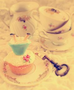 I love the idea of having cupcakes and little keys, like Alice in Wonderland... possibly for the bridal shower?