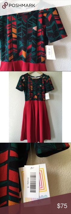 """LuLaRoe Two-Tone Amelia Dress Super cute and rare two-tone Amelia dress.  Measures approximately 39.5"""" in length, 16.5"""" across chest while laid flat, and about 13"""" across waist.  If you're not familiar with the Amelia dress, it has amazing pockets and also has an exposed zipper on the back that goes to the waist.  I get constant compliments whenever I'm wearing one!  I'm not a consultant, just an addict who's downsizing! 😜  Price is firm. LuLaRoe Dresses"""