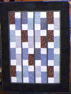 A quilt made from the Passage Quilt's stash of blue fabrics, wonderfully long armed.
