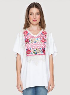 Aileen V-Neck Long Poncho Add the JWLA AILEEN V-NECK LONG PONCHO to your spring wardrobe! This white linen top is cut for an airy poncho fit, and features a bold embroidery design that combines geometric motifs and heirloom needlepoint florals.  - White Linen - V-Neckline, Short Poncho Sleeves, Tunic Length - Signature Embroidery - Care Instructions: Machine Wash Cold, Hang Dry