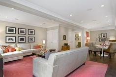 Subtle gray walls and furniture allow the bright bursts of color in this basement to really stand out. Houzzers loved the separate seating areas, which make entertaining large groups easy.