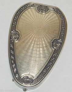 Woodworth, Ornate Silver Trim, egg-shaped compact with Champagne Guilloche Enamel