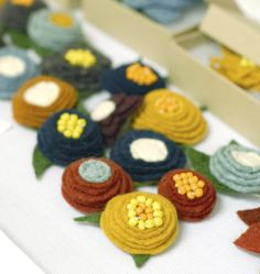I am smitten with felt flower brooches!