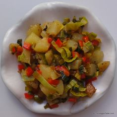 Breakfast favorite home fries are even tastier when dressed up with leeks and red peppers.