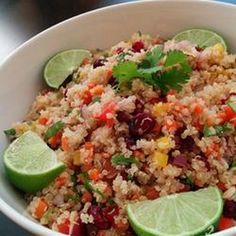 Cranberry and Cilantro Quinoa Salad Recipe Side Dishes, Salads with water, quinoa, red bell pepper, yellow bell pepper, purple onion, curry powder, chopped cilantro fresh, lime, toasted slivered almonds, carrots, dried cranberries, salt and ground black pepper