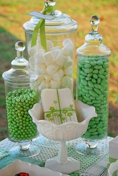 Green candy buffet. Tall apothecary jar of jumbo marshmallows, green Jordan almonds, antique white candy dish