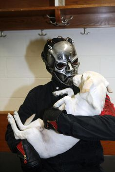 Slipknot's sid wilson holding a puppy