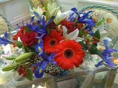 4th of July Explosion!!! (red Gerbera daisies, roses, and berries; blue iris; white lilies) $150