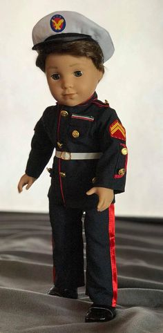 I just had to offer this outfit to my customers in honor of my oldest grandson who just attended the Marine military ball in Las Vegas in November. This Marine Dress Blue uniform is so well made to fit the 18 inch dolls. The blue pants have a red stripe down the leg. The jacket