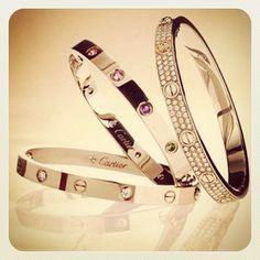 Cartier LOVE bracelets.