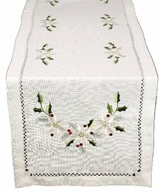Xia Home Fashions Country Poinsettia Embroidered Hemstitch Holiday Table Runner, 15-Inch by 54-Inch by Xia Home Fashions. $32.11. Hemstitch holiday linens featuring embroidered poinsettias and holly.. Machine Washable Made with easy care poliviscose. Machine Washable! Made with easy care poliviscose.. Handrendered cutwork with hemstitch. Handrendered cutwork with hemstitch.. Hemstitch holiday linens featuring embroidered poinsettias and holly. Quality hemstitch and exsquisit...