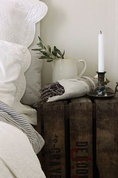 beautiful linens, vintage trunk, fresh lavender, a lovely candle holder and a nice little jug...