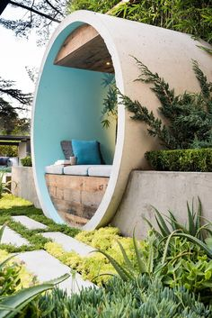 This award winning garden design uses concrete pipes to create seating, a water…