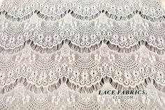 This Ivory white stretch lace fabric features and eyelash pattern accentuated with floral blooms and elegant ornaments. This is a very light weight