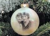 photo ornament - super easy craft, but makes a great gift! I'm thinking this is made by printing/copying the pics on tissue paper, a lot like an earlier craft of printing on the tissue paper and fixing it to wood or a stretched canvas then modge podging it to the ornament.