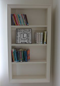 picture frame converted into hanging bookshelf-- tutorial @ Poppies at Play