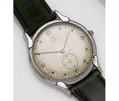 Rolex. A stainless steel manual wind wristwatch  1950's  15-jewel manual wind movement, silvered dial with indented gilt hour dots, outer printed five minute divisions, gilt baton hands, subsidiary seconds at 6, polished round steel case with snap on back, curved lugs, fitted leather strap, case, dial and movement signed