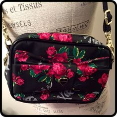 "💥 FLASH SALE! 💥 Betsy Johnson Crossbody Bag Betsey Johnson crossbody bag in black with roses and skulls. Nylon fabric with black patent trim. Adjustable strap. Super cute and mint condition!! Measures 9"" x 6"" x 2"" with a 23"" drop. Zip close. 👛 NO holds trades or PayPal 👛 Betsey Johnson Bags Crossbody Bags"