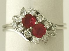 'Vintage Cocktail Ring with Ruby in 18ct White Gold' http://www.acsilver.co.uk/shop/pc/0-70-ct-Ruby-and-0-56-ct-Diamond-18-ct-White-Gold-Cocktail-Ring-Vintage-Circa-1970-176p6943.htm