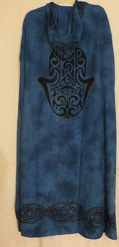Up for sale is the Blue and Black Robe with Hamsa Hand Design pictured. The cloak is hooded as you can see. A great item to wear when attending Rituals, Festivals and Renaissance Faires. The beautiful