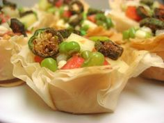 A few months ago, I made a version of a chaat that I had eaten last summer at my favorite North Indian restaurant in New York , Devi . Vegetarian Appetizers, Vegetarian Recipes, Snack Recipes, Indian Snacks, Indian Food Recipes, India Food Culture, Chef Dishes, Comida India, Chaat Recipe