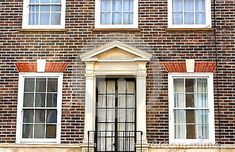 An exterior of the Georgian brick facade of a seaside building in Eastbourne in East Sussex England.