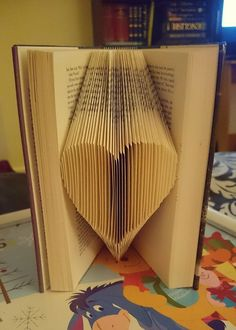 folded page book art tutorial! FINALLY. I feel bad knowing I'm gonna do this to a book.