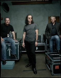 Is it me or does Alex look like he sees a spider on Geddy's back?