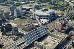 Station Amsterdam Bijlmer Arena en Heineken Music Hall met in de Achtergrond De Amsterdam Arena en de Ziggo Dome.foto: Marco van Middelkoop/Aerophoto-Schiphol