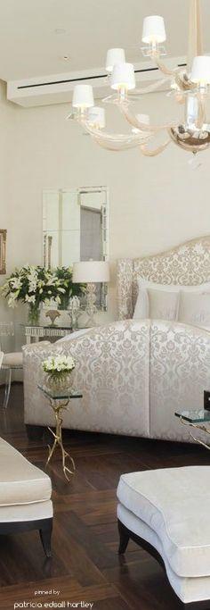 White satin damask print upholstered bed
