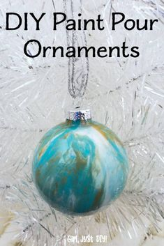 Make these fun DIY Paint Pour Christmas Ornaments in various colors for an inexpensive and budget friendly craft to give as gifts to family and friends. Diy Christmas Ornaments, How To Make Ornaments, Holiday Crafts, Christmas Bulbs, Holiday Tree, Christmas Decorations, Christmas Ideas, Easy Ornaments, Handmade Christmas