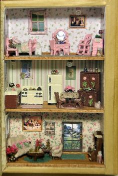 Dollhouse miniatures - Mini treasures wiki / ac141214The Hummingbird Book by Kristie Norman The Hummingbird book came from the smallest of three Punch Studio Keepsake nesting boxes. It made a perfect 144th scale scene. The book opens to reveal three floors, parlor, kitchen/diningroom, and bedroom. All of the furniture came from Virtual Dollhouse. I choose a variety of metal furniture, making sure it was small enough to fit on each floor.