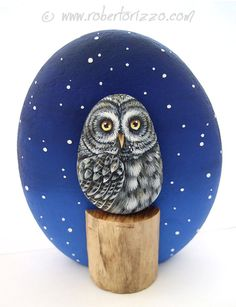 Hand Painted Great Grey Owl Rock! A Unique Piece of Art and a great Gift Idea for all of you, owl lovers!  A pebble owl and a trunk section applied with a super glue on a larger one decorated with a snowy winter sky!  My painted stones are unique pieces of art. I paint all of them with high quality acrylics and very small brushes. They are FINELY DETAILED, protected with a strong transparent varnish coat, signed on the back and accompanied by a CERTIFICATE OF AUTENTICITY.  Measurements of…