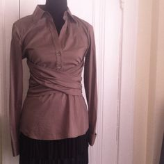 BCBGMAXAZRIA Classy Dress Shirt NWOT Beautiful long sleeve classic blouse.  Hidden side zipper. • Sashes crisscross in front and tie in back. Long sleeve with french style button cuff.  Never worn. Excellent condition. No size inside. But fits a 2-4. This is a great fitted blouse very hard to find. BCBGMaxAzria Tops