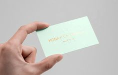 Copper foiled and blind embossed business card for Mona De Castellarnau designed by Anagrama