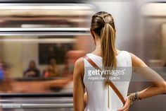Foto stock : Rear View Of Woman Standing In Front Of Train At Subway Station