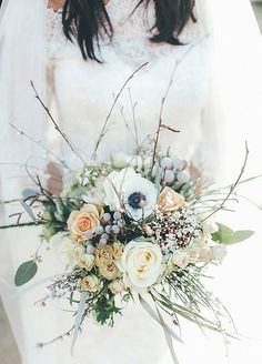 The understated colors in this bouquet are anything but simple when paired with greenery for a winter wedding.
