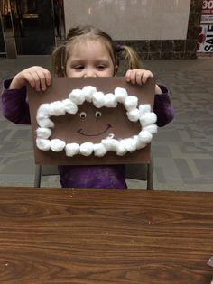 Toddler Tuesday was SO much fun today (and a little messy--thanks to all who helped clean up) with our April Showers theme! We played with Moon Sand, created coffee filter umbrellas, and made happy rain clouds.